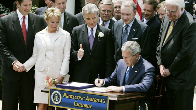With John and Reve Walsh watching, President George W. Bush signs the Adam Walsh Act on July 27, 2006.