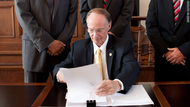 Gov. Robert Bentley signs Alabama's tough new immigration bill into law in June. The Justice Department is challenging the law.