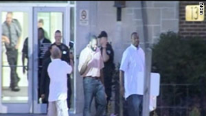 Kwame Kilpatrick, center, leaves a state facility in Jackson, Michigan, Tuesday morning.