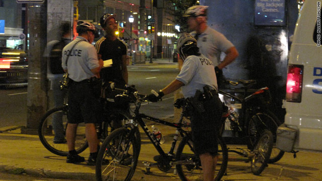 Police on bicycles detain a minor for a curfew violation in Philadelphia.