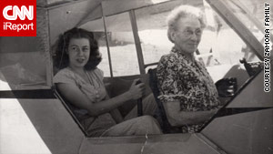 Peggy Zamora,  left, in her teenage years learned to fly an airplane.  Her grandmother is seated in front.