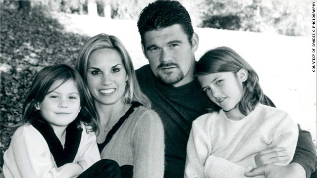 Chris and Shane Dronett, and their two children, Hayley and Berkley, in 2002.