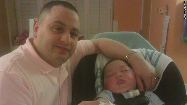 &quot;Baby Joseph,&quot; who is in the center of an end-of-life debate flew home after receiving a tracheotomy that a hospital had refused.
