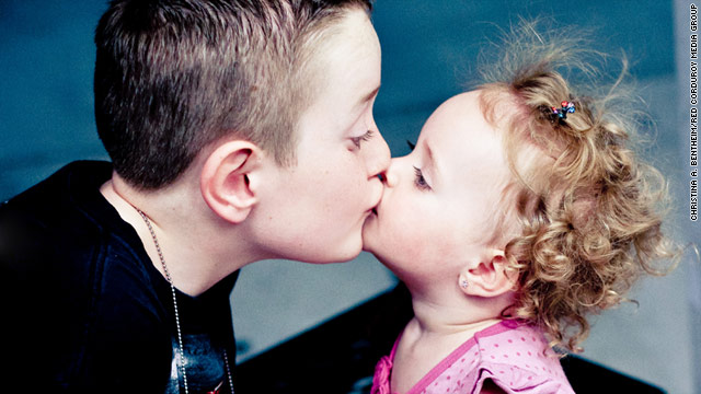 Tristan Saghin kisses his younger sister, Brooke. Tristan saved Brooke's life after she fell into a swimming pool last month.