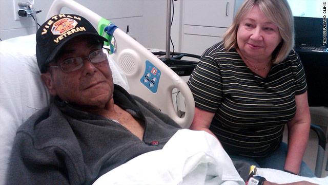 Wilson Alvarado rests at the Cleveland Clinic with his wife, Patricia, by his side. He recently had a liver transplant.