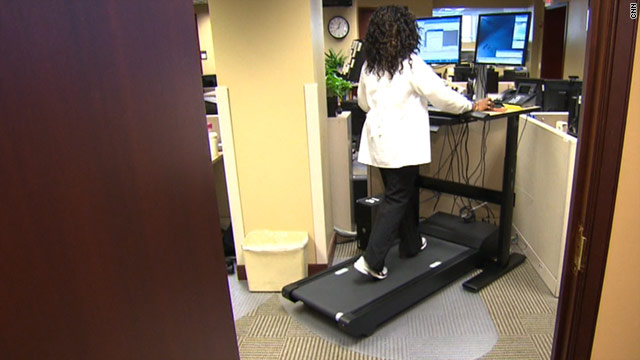 More employers are providing adjustable stand/sit workstations and treadmill desks, above, which run at low walking speeds.