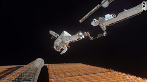 Scott Parazynski, on space shuttle mission STS-120 in 2007, repaired a solar panel array.