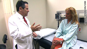 Dr. Arthur Agatston consults with Judy Willner about her checkup in his Miami office.