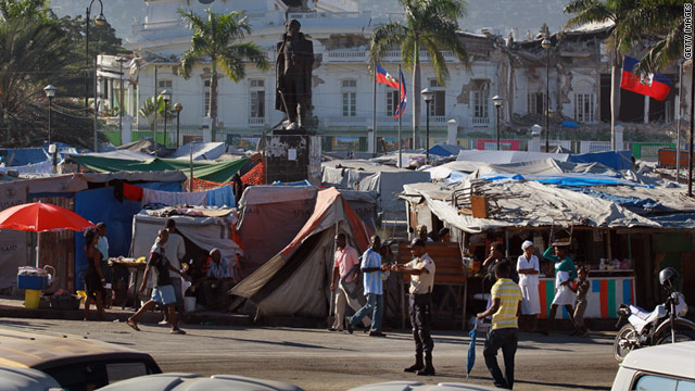 People displaced by the massive earthquake continue to live in tents in front the rubble of the Presidential Palace a year later.