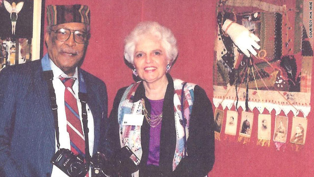 Photographer Ernest Withers and artist Martha Huie in front of her artwork at a 1997 exhibition in Memphis, Tennessee.