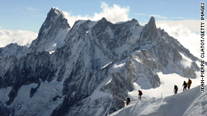 People climb to the top of the Aiguille du Midi in the French Alps.