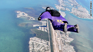 A skydiver with a wingsuit soars over the Florida Keys.