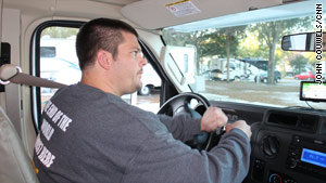 Adam Larsen takes the wheel as his caravan team leaves a Tampa, Florida, RV park.