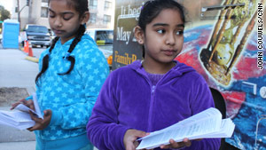 Arianna Ramrajie, 7, right, joins her sister, Breana, 8, in sharing the doomsday message.