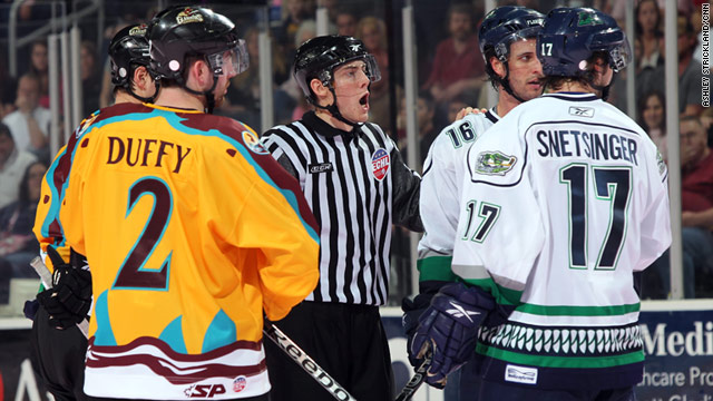 Breaking up fights on the ice is just another day on the job for hockey linesman Alex Stagnone (center).