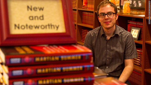 "Andrew Kessler sits in a section of his bookstore that sells only one book: ""Martian Summer."""