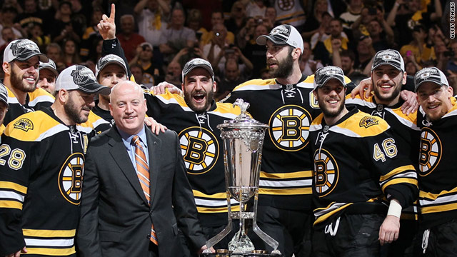 The Boston Bruins pose with -- but don't touch -- their conference trophy after beating Tampa Bay on May 27, 2011.