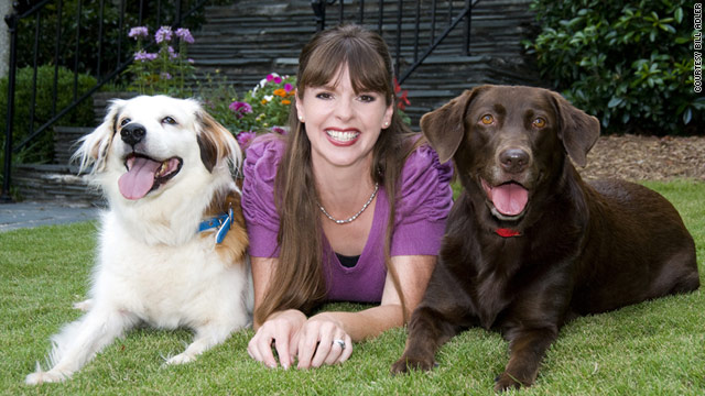 Dog trainer Victoria Stilwell poses with her two dogs.