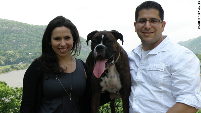 Michelle Przybyksi, 26, and Andy Lalinde, 33, pose with their dog Domino at West Point last month. The couple met through an exclusive online dating website for college students.