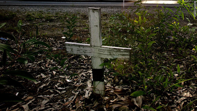 A cross marks the site of a death on an Australian roadside. Darin Strauss was haunted for