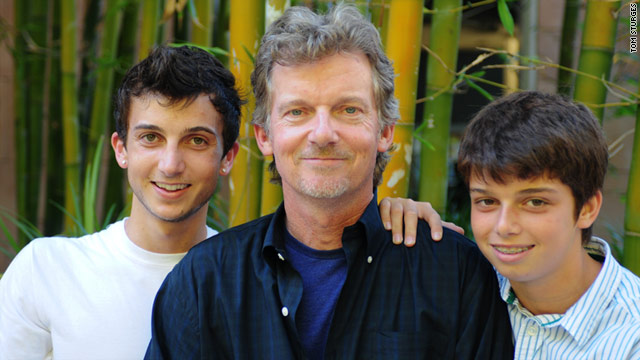 Tom Sturges poses with his two teenage sons, Thomas (left) and Sam.