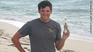 "Clint Buffington displays a ""fresh catch"" on the beach."
