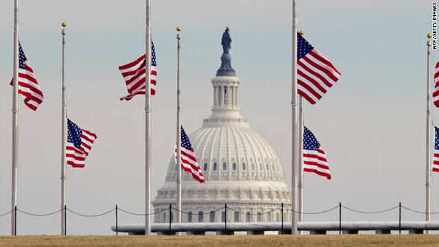 Flags fly at half-staff at the Washington Monument (with the U.S. Capitol in the background) to honor victims of the shooting.