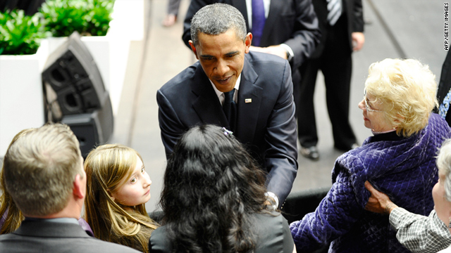 President Barack Obama greets family members of shooting victims during a memorial event in Tucson, Arizona.