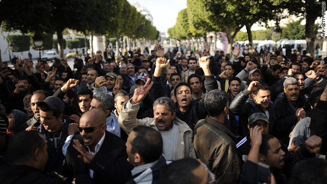 People demonstrate in Tunis, Tunisia, on Monday, demanding the abolition of the party of ousted President Zine El Abidine Ben Ali.