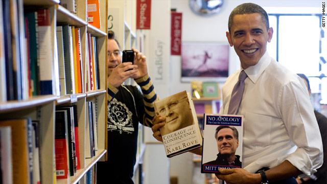 President Obama holds up Mitt Romney's book at the Prairie Lights Bookstore  in Iowa City, Iowa, March 25, 2010.