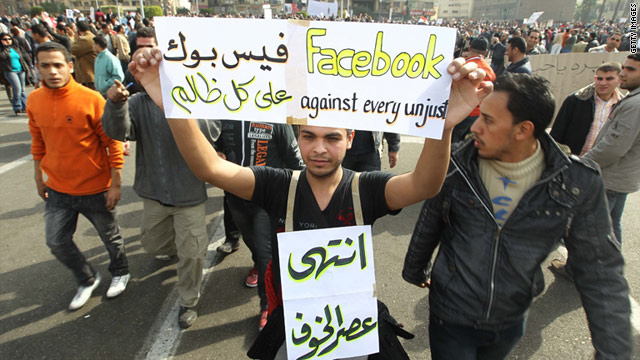 An Egyptian man holds up a sign praising Facebook, joining other protesters in Cairo's Tahrir Square on February 1.