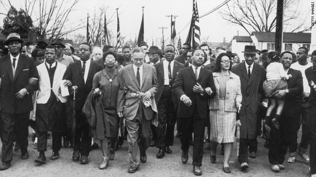 Martin Luther King and his wife, Coretta Scott King, lead a black voting rights march from Selma, Alabama, to the state capital.