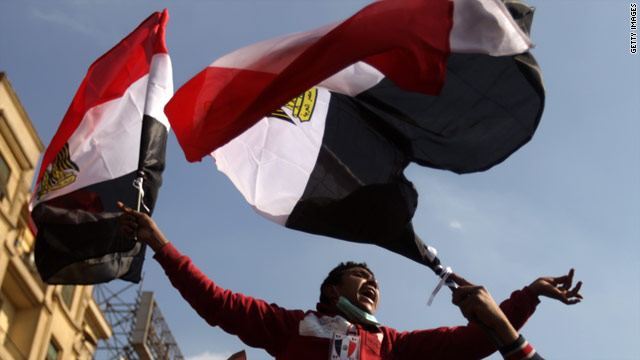An anti-government protester celebrates in Cairo's Tahrir square on the day after Hosni Mubarak's ouster.