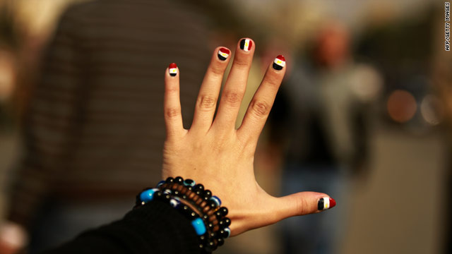 An Egyptian girl flashes her nails painted with the colors of her national flag in Cairo's Tahrir Square.