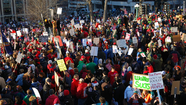 Protesters rally at Wisconsin's state capitol to oppose the governor's bill restricting collective bargaining rights.