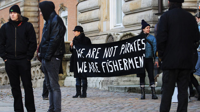 Demonstrators hold banners during a trial against Somali pirates in Hamburg, Germany, in November.