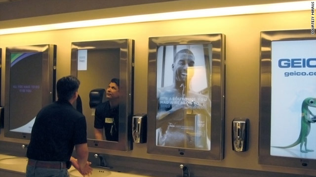 A North Carolina company is selling a system for advertisers to reach consumers via airport mirrors.
