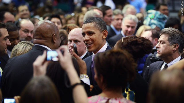President Barack Obama greets people as he visits Miami Central Senior High School in Florida on March 4.