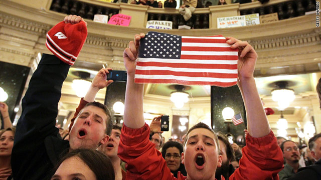 A protester holds an American flag during a demonstration inside the Wisconsin Capitol on Wednesday.