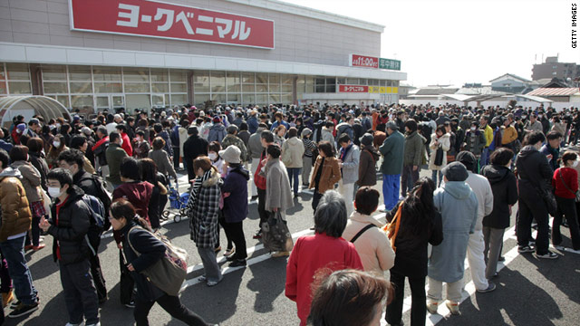 People line up to buy food and daily necessities at a supermarket in Sendai city, Miyagi prefecture, on Monday