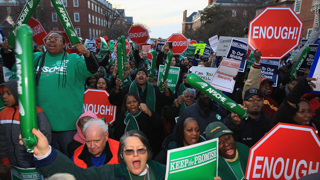 Unionized public workers rally at the Maryland State Capitol to protest proposed pension changes.