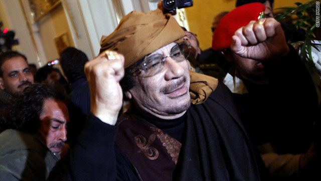 Libyan leader Moammar Gadhafi gestures as he arrives at the Rixos Hotel inl Tripoli, Libya, on March 8, 2011.