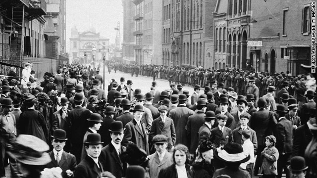 Crowds of people wait to identify bodies of immigrant workers who died in the Triangle Waist Co. fire in  New York City, 1911
