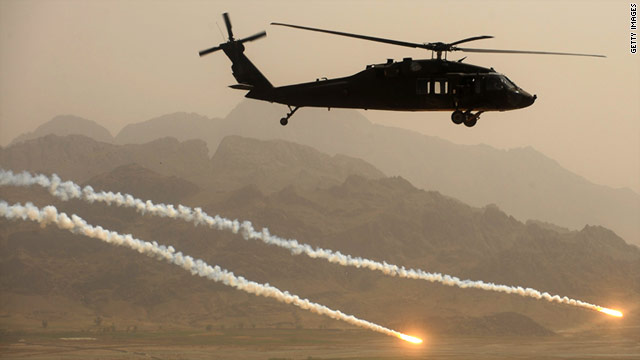 A U.S. Army Blackhawk helicopter fires protective flares while  over Kandahar province in Afghanistan.