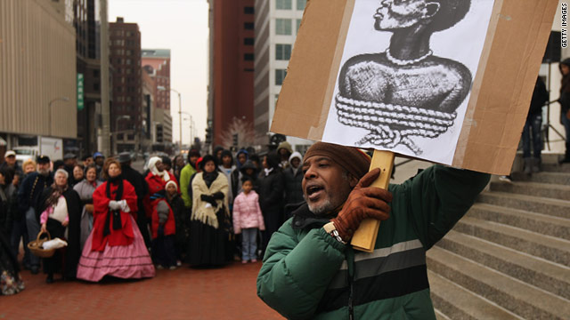 A man protests a slave auction re-enactment in St. Louis, Missouri, held to observe  the 150th anniversary of the Civil  War.