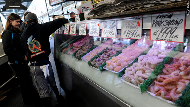 A customer checks out the seafood at The Pike Place Fish market in Seattle, Washington.