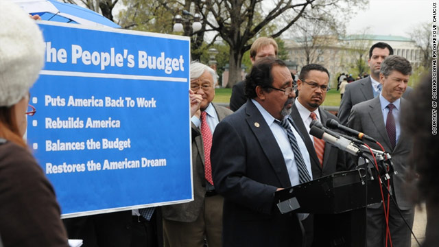 Rep. Raul Grijalva, at the microphone, is joined by Rep. Mike Honda, on the left behind him, and Rep. Keith Ellison, to the right.