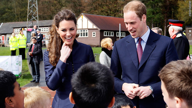 Kate Middleton and Prince William talk with youngsters from a local soccer club at Witton County Park in the U.K. on April 11.