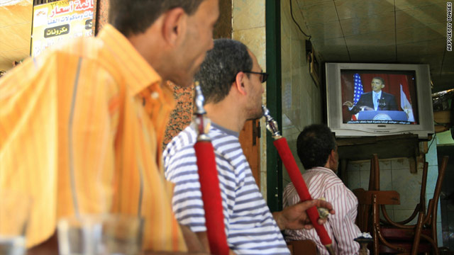 Men at a Cairo coffee shop watch U.S. President Barack Obama deliver his speech to the Muslim world in June 2009.