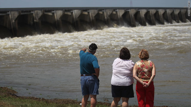 People watch the Bonnet Carré Spillway in Norco, Louisiana, open to divert water from the Mississippi into Lake Pontchartain.